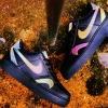 A pair of Nike trainers, black with orange and pink detail
