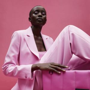 Model in pink Ted Baker tailoring, with matching clutch