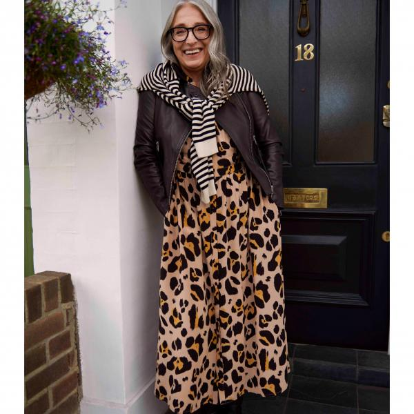 A woman with glasses wearing leopard print dress. Part of John Lewis capsule collection, curated by Erica Davies